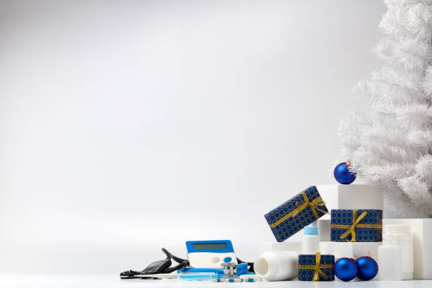 Stethoscope, medical devices and Christmas decorations. stock photo