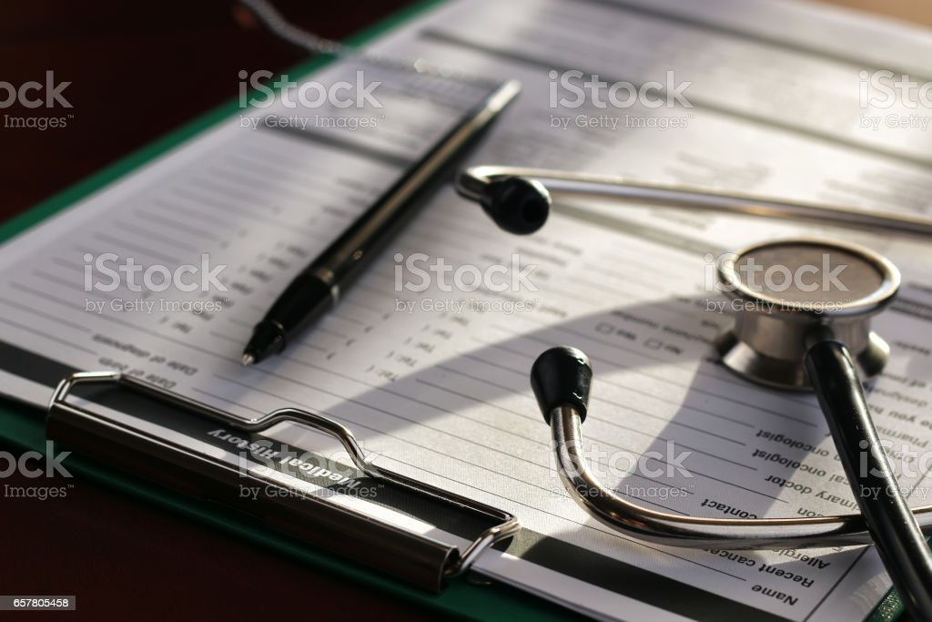 stethoscope and medical documents with pen on a table