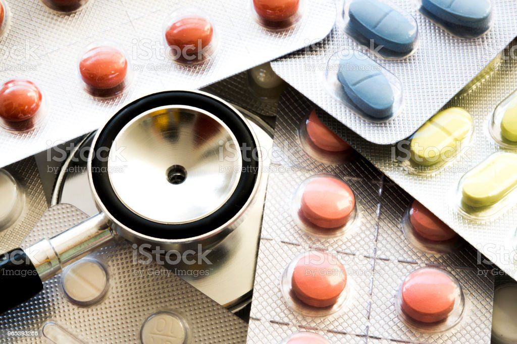 Stethoscope, medicine and pills close up royalty-free stock photo