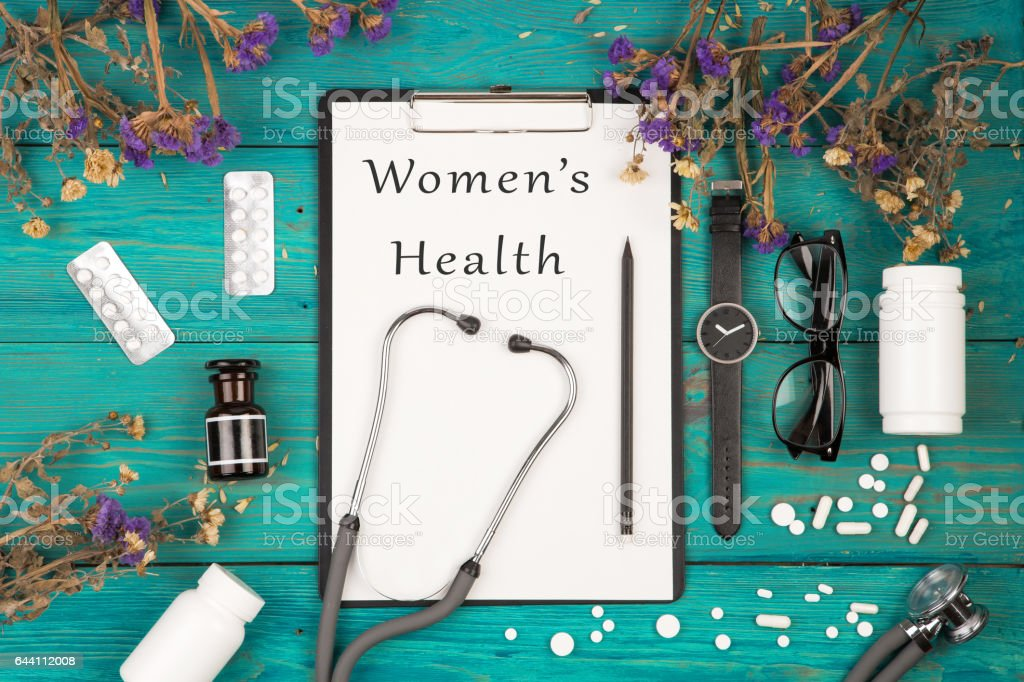 stethoscope, medicine clipboard with text 'Women's Health' stock photo