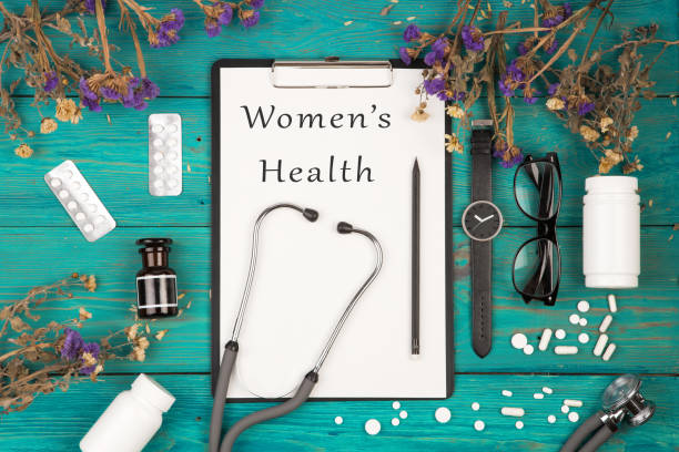 "stethoscope, medicine clipboard with text ""women's health"" - screening stock photos and pictures"