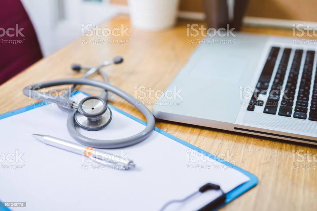 Stethoscope medicine with laptop computer doctor and hospital heath care workplace concept stock photo