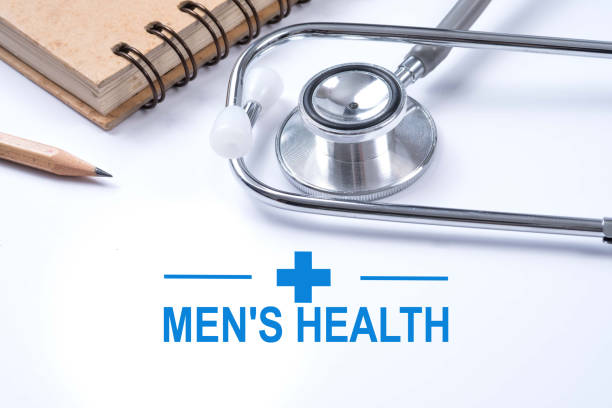 Stethoscope, notebook and pencil with men's health words. Health concept. stock photo