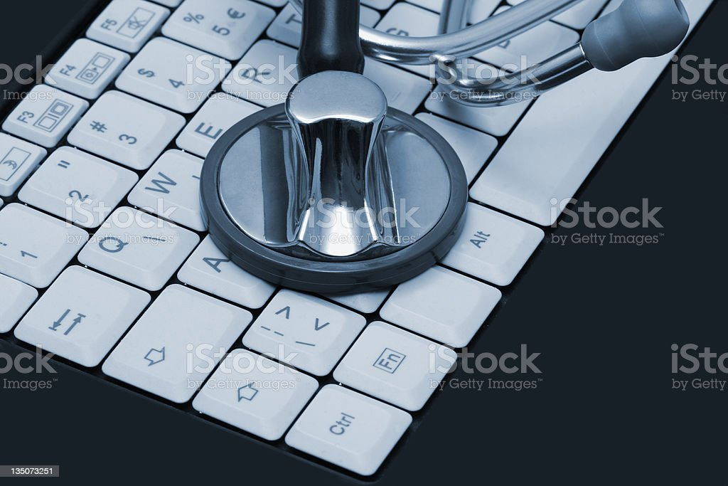 Stethoscope on a computer keyboard in blue royalty-free stock photo