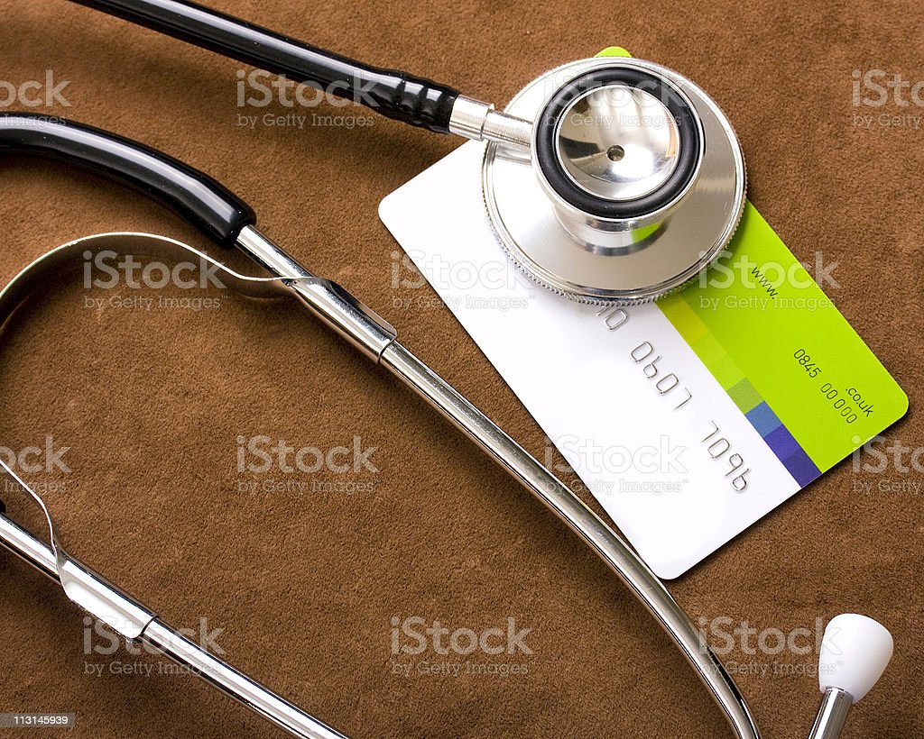 Stethoscope on a credit card stock photo