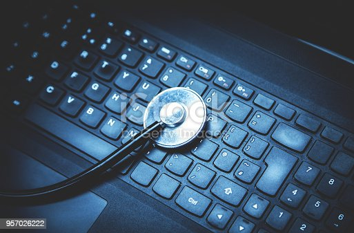 istock Stethoscope on a laptop keyboard. 957026222