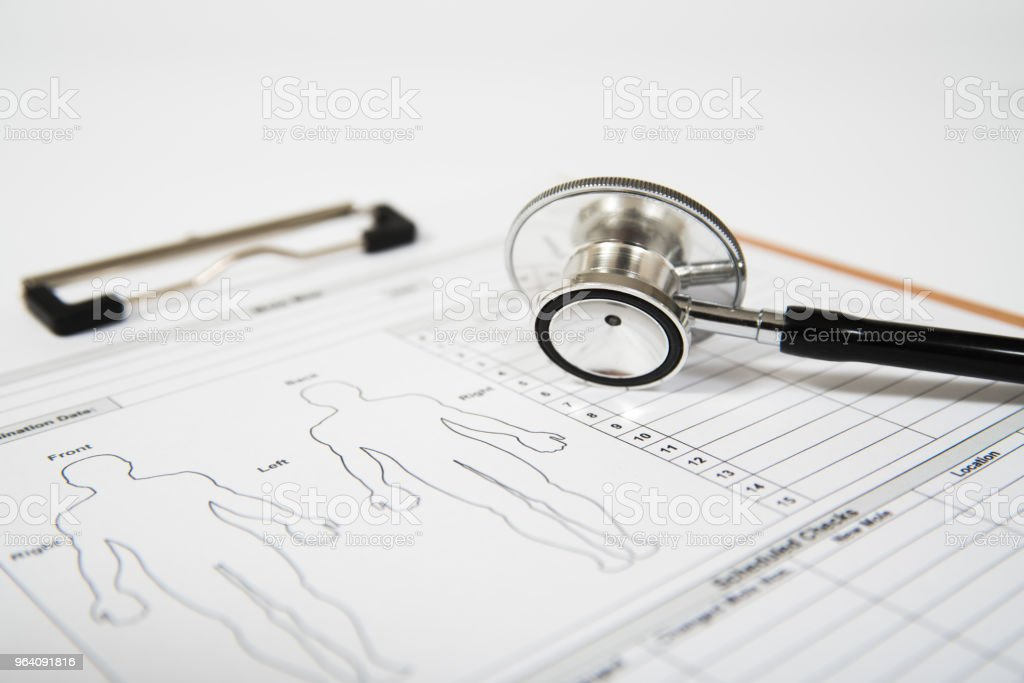 Stethoscope on a medical form. Healthcare concept - Royalty-free Care Stock Photo