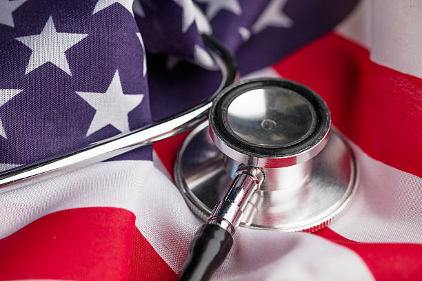 Stethoscope on an american stars and stripes flag stock photo