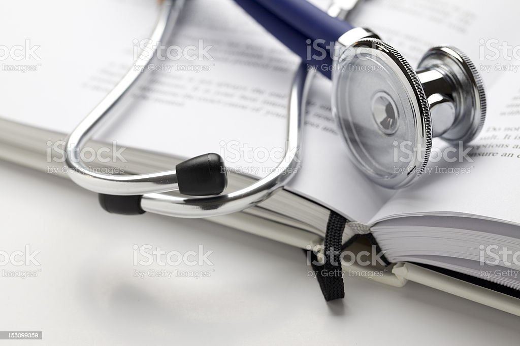 Stethoscope on book stock photo