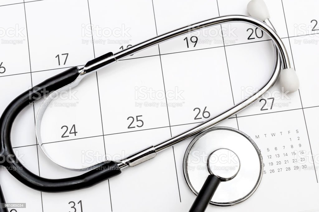 stethoscope on calendar medical appointment concept stock photo