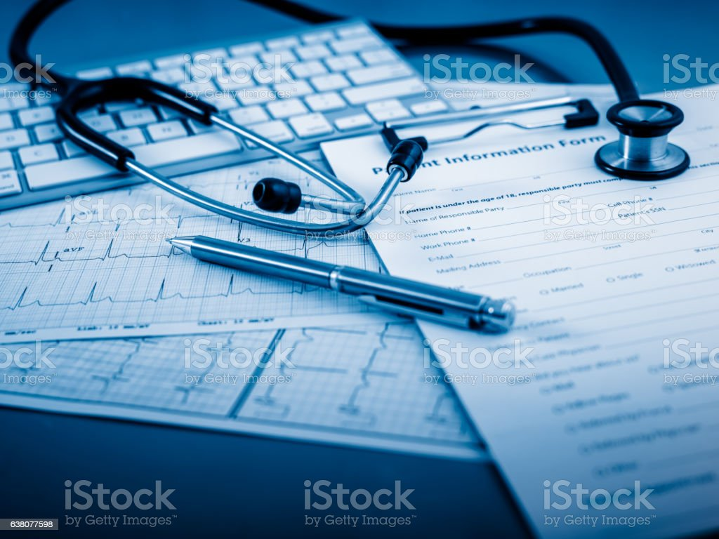 Stethoscope on cardiogram concept for heart care stock photo