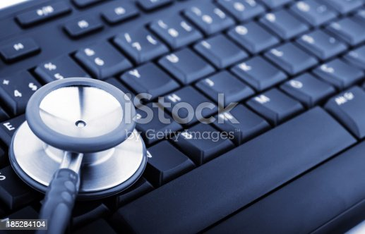 istock Stethoscope on computer keyboard 185284104