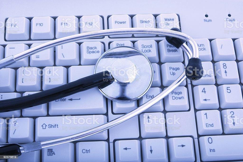 stethoscope on  computer keyboard royalty-free stock photo