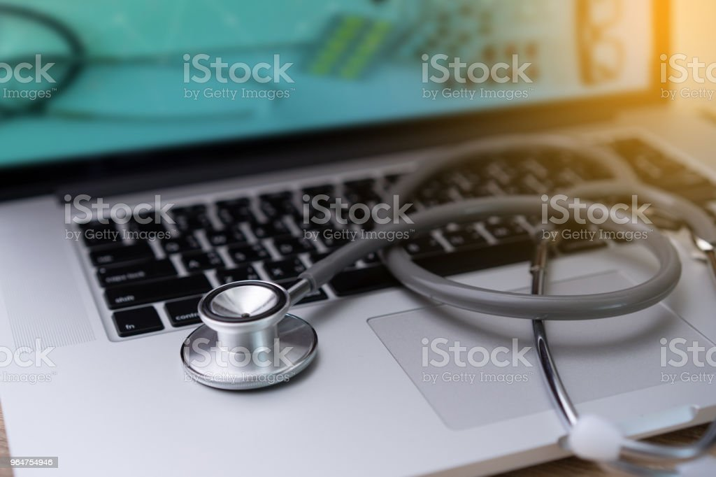 stethoscope on laptop Doctor working in hospital Healthcare and medical concept test royalty-free stock photo
