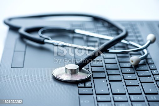 Stethoscope on laptop keyboard. Healthcare And Medicine Concepts