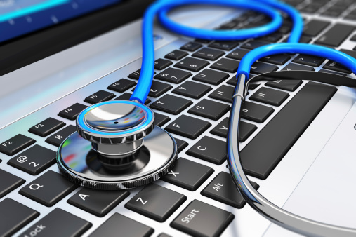 istock Stethoscope on laptop keyboard 163751742