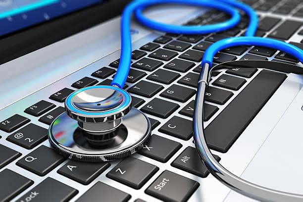 stethoscope on laptop keyboard - stetoskop bildbanksfoton och bilder