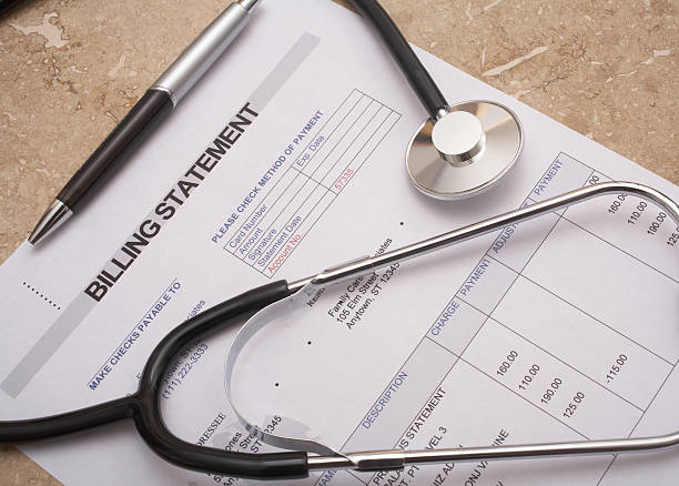 Stethoscope on medical bill statement stock photo