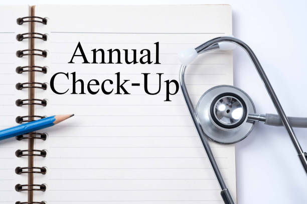 Stethoscope on notebook and pencil with Annual Check-Up words as medical concept. stock photo