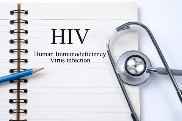 Stethoscope on notebook and pencil with HIV (Human Immunodeficiency Virus)  words as medical concept stock photo