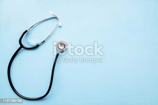 istock Stethoscope on pastel blue table. Doctor tool for heartbeat and noise of lungs listening. Healthcare concept. Empty place for text, quote, sayings or logo.  Top view. 1137285796