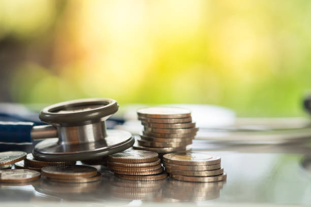 Stethoscope on stack of coins, concept of Financial Health stock photo