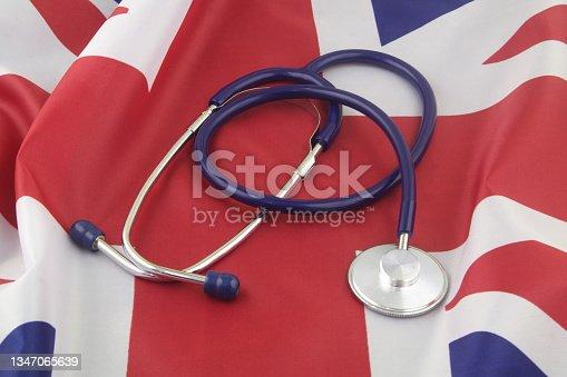 istock Stethoscope on United Kingdom flag. 1347065639