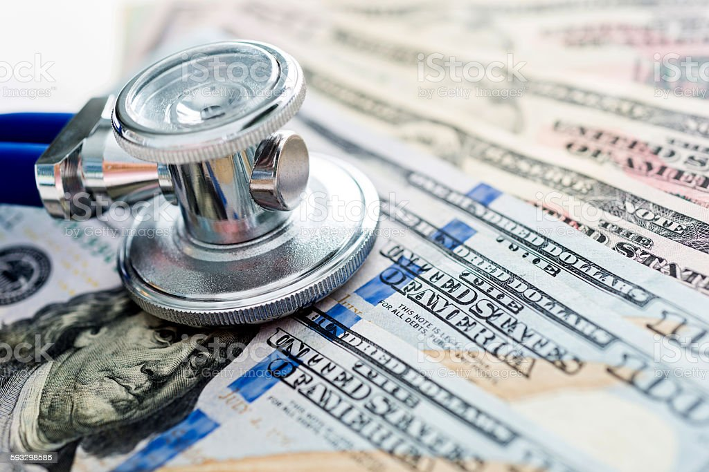Stethoscope on us paper currency stock photo