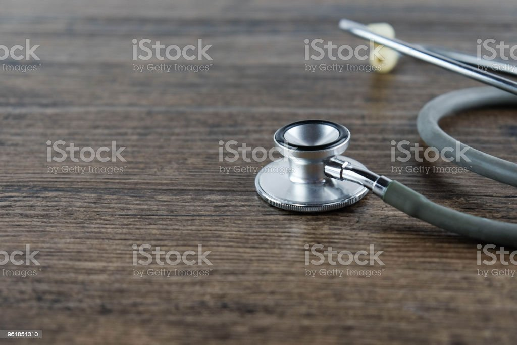 Stethoscope on wooden table background. medical health concept royalty-free stock photo