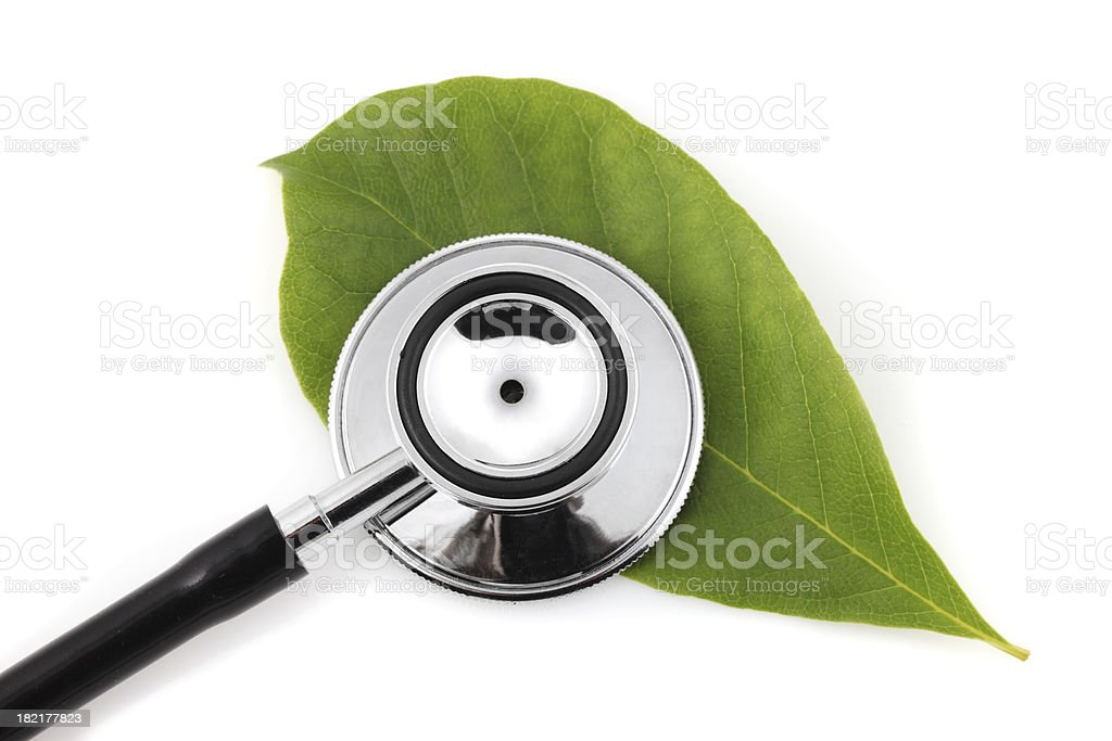 Stethoscope over green leaf royalty-free stock photo