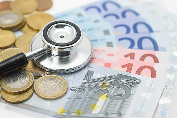 Stethoscope placed on Euro currency stock photo