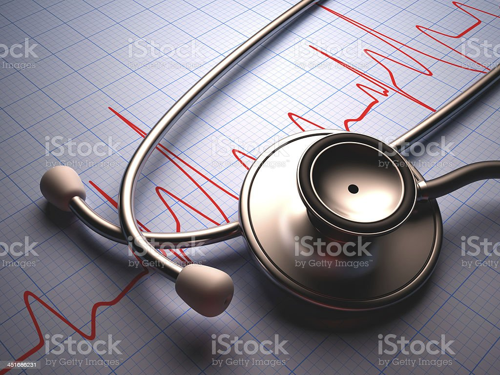 Stethoscope resting on heart rate graph stock photo