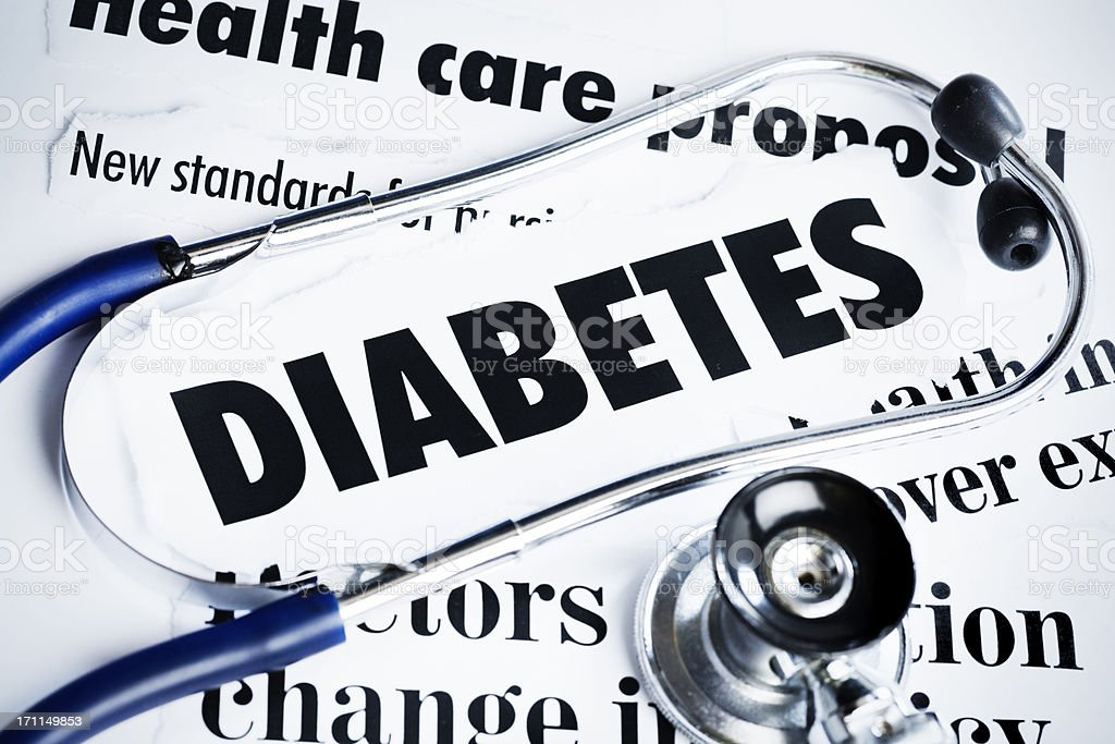 Stethoscope rests on headlines concerning diabetes royalty-free stock photo