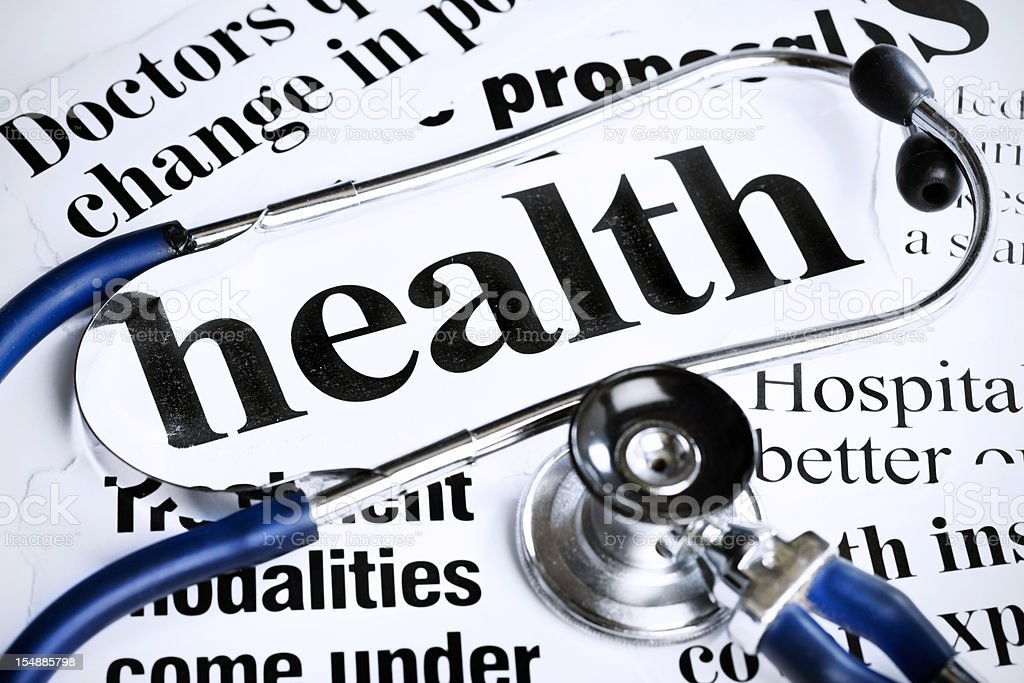 Stethoscope rests on newspaper headlines about health issues royalty-free stock photo