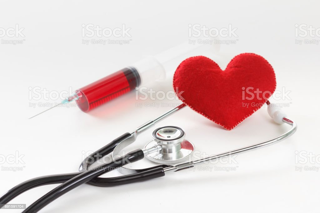 Stethoscope, syringe and heart. Healthcare concept. stock photo