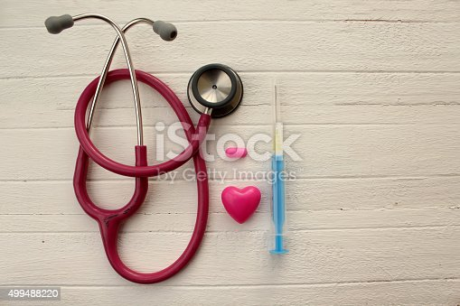 istock Stethoscope, syringe, pill and heart 499488220