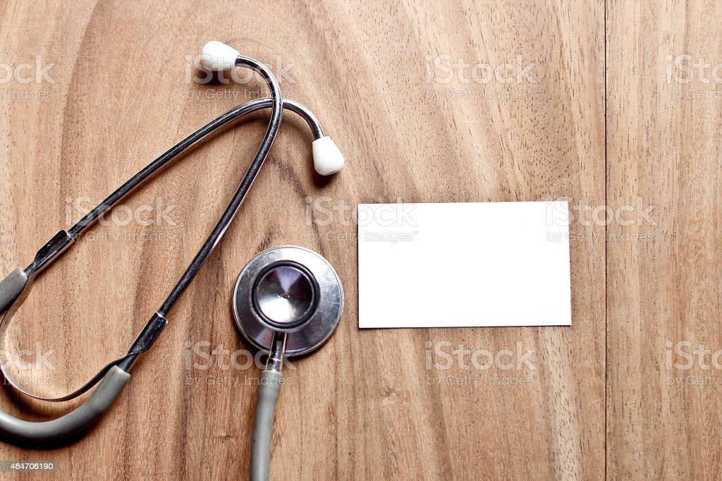Stethoscope with a blank white card stock photo