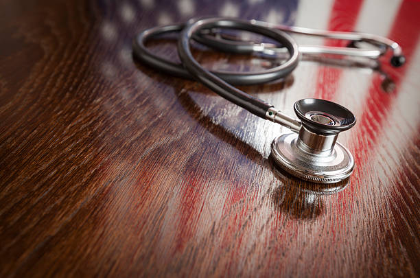 Stethoscope with American Flag Reflection on Table stock photo
