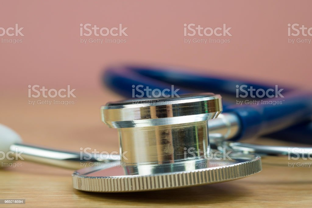Stethoscope with blue tube on table, health and medical concept. royalty-free stock photo