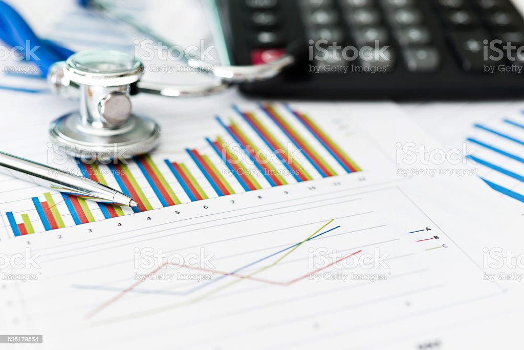 Stethoscope with business graph and calculator stock photo 636179554 bar graph calculator chart data document ccuart Image collections