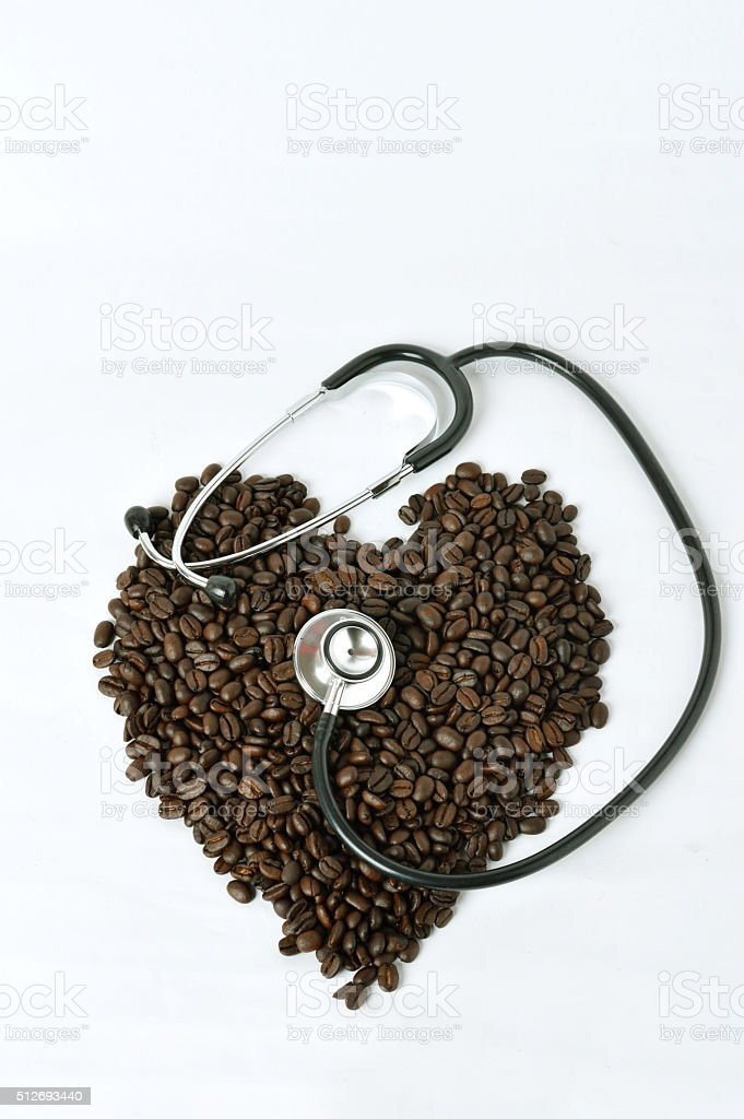 stethoscope with coffee beans stock photo