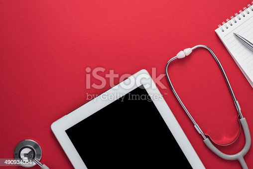 Stethoscope with digital tablet and note on the desktop. Medicine concept.Top view with copy space