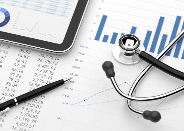 Stethoscope with financial statement digital tablet stock photo