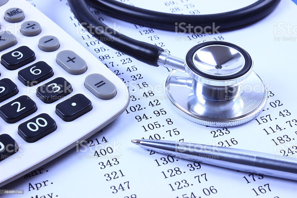 Stethoscope with financial statement stock photo