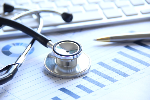 istock Stethoscope with financial statement 695148314