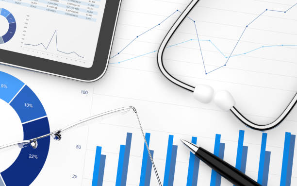 Stethoscope with financial statement with digital tablet stock photo