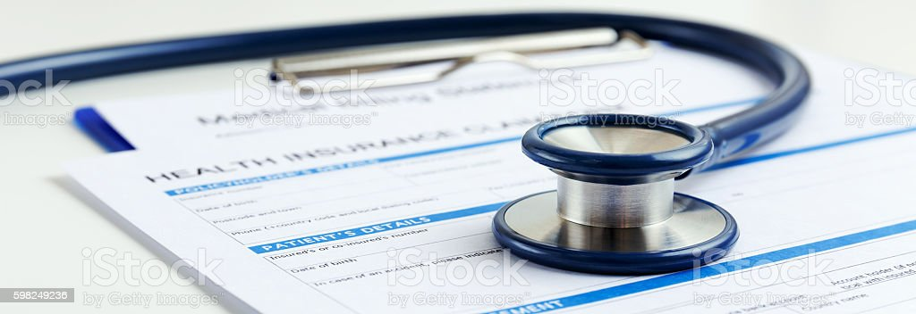 Stethoscope with health insurance stock photo