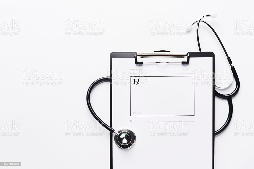 Stethoscope with prescription pad on clipboard with copy space. stock photo