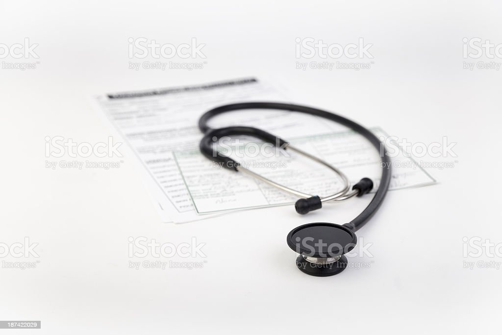 Stethoscope with record cards in the background royalty-free stock photo