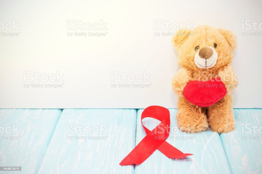 stetoscope, red heart and bear on blue background with red heart stock photo